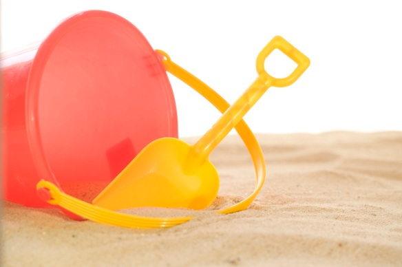 Child's Shovel and Pail at the Beach