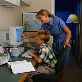 child teacher computer